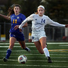 St. Charles North's Alison Wessel and Lyons Township's Bella Lestina chase after the ball during a game at Batavia High School on April 13.