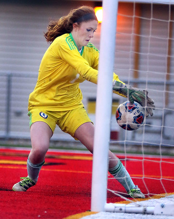 Lyons goal keeper Claire Purcell grabs the ball before it crosses the goal line during a game against St. Charles North at Batavia High School on April 13.