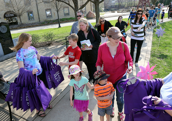 Josie McNally, left, of Batavia hands out goodie bags during an Egg Hop at the Peg Bond Center in Batavia April 15.