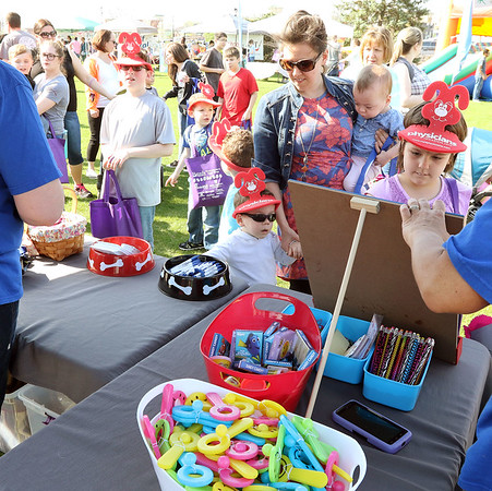 There were many giveaways, including at the Batavia Animal Clinic booth, during an Egg Hop at the Peg Bond Center in Batavia April 15.
