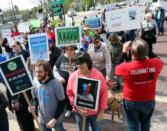 A March for Science heads north on Third Street in downtown Geneva April 22.