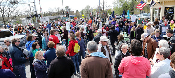 People gather at the Geneva Metra Station for a March for Science April 22.
