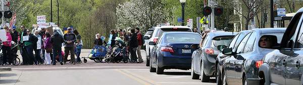 A March for Science temporarily blocks southbound traffic on Third Street in downtown Geneva April 22.