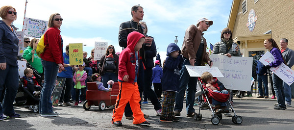 People gather at the Geneva Metra Station for a March for Science in downtown Geneva April 22.