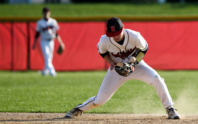 Jenny Kane - jkane@shawmedia.com Huntley's Brody Burkart fumbles with a grounder hit to second during the top of the third inning of their game against Boylan. Huntley lost to Boylan 7-0 during their non-conference matchup.