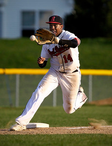 Jenny Kane - jkane@shawmedia.com Huntley's Bryce Only fields a ground ball hit to third base, and attempts to make the out at first. Only over threw first allowing the Boylan runner to be safe. Huntley lost to Boylan 7-0 during their non-conference matchup.