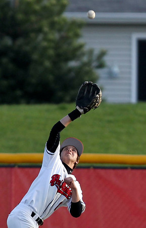 Jenny Kane - jkane@shawmedia.com Huntley's Nick Corpolongo makes an out in left field during their game against Boylan. Huntley lost 7-0 during their non-conference matchup.