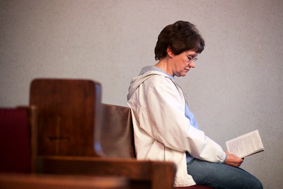 Jenny Kane - jkane@shawmedia.com Sharon Reid reads scripture during her volunteer hour at the Church of Holy Apostles' All Saints Perpetual Adoration Chapel in McHenry. The chapel is open to the public 24 hours a day.