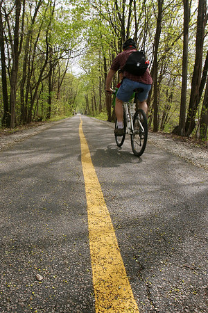 Mike Greene - mgreene@shawmedia.com A biker rides along the Fox River Trail Tuesday afternoon in Algonquin. The trail, which ends at Riverfront Park in Algonquin, is popular for bikers, runners and walkers for its scenic views along the Fox River.