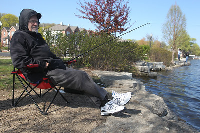 Mike Greene - mgreene@shawmedia.com Odi Jendo, 72, of Crystal Lake, sits in his favorite fishing spot along the Fox River Monday afternoon at Riverfront Park in Algonquin. Jendo enjoys traveling to the park for the view of the river.
