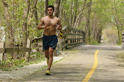 Mike Greene - mgreene@shawmedia.com Eber Becerra, 22, of Carpentersville, runs along the Fox River Trail Tuesday afternoon in Algonquin. The trail, which ends at Riverfront Park in Algonquin, is popular for bikers, runners and walkers for its scenic views along the Fox River.