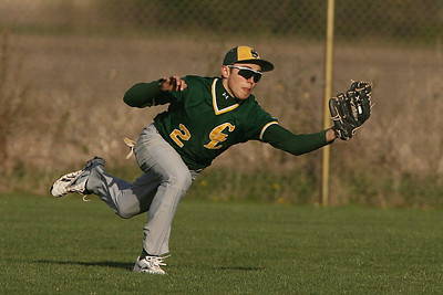 Mike Greene - mgreene@shawmedia.com Crystal Lake South's Jake Bigos (cq) reaches out to make a catch in left field during a game against Marian Central Wednesday, April 4, 2012 in Woodstock. Crystal Lake South won the game 7-1.