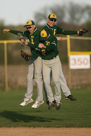 Mike Greene - mgreene@shawmedia.com Crystal Lake South's Jake Bigos (left), Nick Severino, and Will Ahsmann celebrate in the outfield after the Gators victory over Marian Central 7-1 Wednesday, April 4, 2012 in Woodstock.