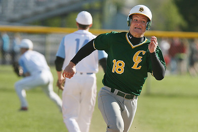 Mike Greene - mgreene@shawmedia.com Crystal Lake South's Jordan Van Dyck (cq) hustles towards third base after a hit during the first inning of a game against Marian Central Wednesday, April 4, 2012 in Woodstock. Van Dyck tripled on the play, knocking in one run and helping the Gators defeat the Hurricanes 7-1.