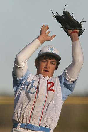Mike Greene - mgreene@shawmedia.com Marian Central's Tony Milone (cq) catches an infield fly during a game against Crystal Lake South Wednesday, April 4, 2012 in Woodstock. Marian Central was defeated 7-1.