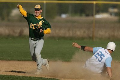 Mike Greene - mgreene@shawmedia.com Crystal Lake South's Tyler Salm (cq) attempts to complete a double-play as Marian Central's Scott Taylor slides into second base Wednesday, April 4, 2012 in Woodstock. The double-play was unsuccessful, but Taylor was forced out at second. Crystal Lake South defeated Marian Central 7-1.