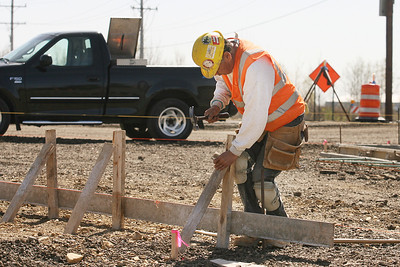 Mike Greene - mgreene@shawmedia.com Ambrsio Vasquez (cq), of Lake Zurich, hammers in a support stake Wednesday, April 4, 2012 at the corner of Rakow Rd. and Pingree Rd. in Crystal Lake. The construction project, started in the spring  of 2011, will add lanes and widen Rakow Rd. and is scheduled to be completed in the fall of 2012.