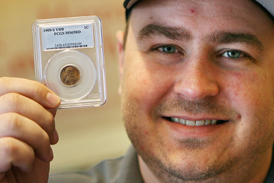 Mike Greene - mgreene@shawmedia.com Marengo Coin & Gun Shop owner, Dominic Debock (cq), holds up a 1909-S VDB penny valued at $6,000 Thursday, April 5, 2012 at his shop in Marengo. Support for the US penny is strong despite Canada's recent move to eliminate their penny