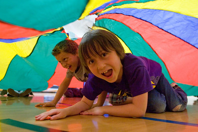 Mike Greene - mgreene@shawmedia.com Jacob Sinchak (front), 8, and Triston Lunzer, 10, crawl under a parachute while playing a game as part of a kick-off event held Friday, April 6, 2012 to promote health and nutrition at Woodscreek School in Crystal Lake. The event was made possible by a grant from the American Cancer Society to the McHenry County Department of Health.