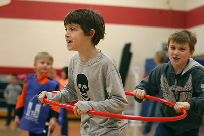 Mike Greene - mgreene@shawmedia.com Connor Roth, 8, is pursued by James Kachel, 9, while playing a game as part of a kick-off event promoting health and nutrition at Woodscreek School Friday, April 6, 2012 in Crystal Lake. Roth was one of over 100 children who participated in a variety of games made possible by a grant from the American Cancer Society.