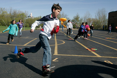 Mike Greene - mgreene@shawmedia.com Tyler Compiani, 9, races around the black top while playing a game at Woodscreek School Friday, April 6, 2012 in Crystal Lake. Roth was one of over 100 children who participated in a variety of games made possible by a $8,200 grant given to the McHenry County Department of Health by the American Cancer Society.