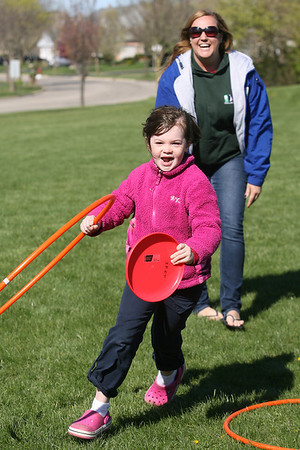Mike Greene - mgreene@shawmedia.com Natalie Yassick, 7, runs back to her teammates while playing a game as part of a kick-off event promoting health and nutrition at Woodscreek School Friday, April 6, 2012 in Crystal Lake. Yassick was one of over 100 children who participated in a variety of games made possible by a grant given to the McHenry County Department of Health.