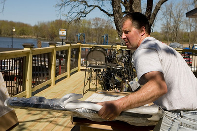 Mike Greene - mgreene@shawmedia.com Chris Seils (cq), manager of Broken Oar, works on setting up tables for a new second-floor outdoor deck overlooking the Fox River Friday, April 6, 2012 in Port Barrington. The deck, which will feature tables and barstools overlooking the river, has been in the works for about two years according to Seils.