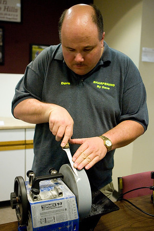 Mike Greene - mgreene@shawmedia.com David Nells, owner of Sharpening by Dave, sharpens a knife at the Algonquin/Lake in the Hills Chamber of Commerce Monday, April 9, 2012 in Lake in the Hills. Nells has been in the trade for 12 years and attends farmers markets from Geneva to Lake Shore Drive offering his services.