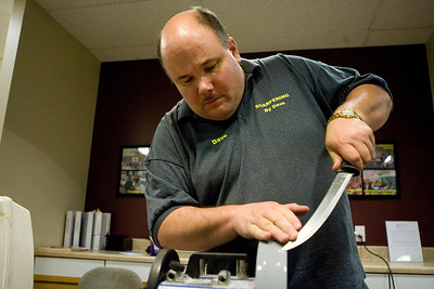 Mike Greene - mgreene@shawmedia.com David Nells, owner of Sharpening by Dave, guides a blade along a sharpening stone at the Algonquin/Lake in the Hills Chamber of Commerce Monday, April 9, 2012 in Lake in the Hills. Nells has been working in the sharpening trade for 12 years and offers prices below the national average.