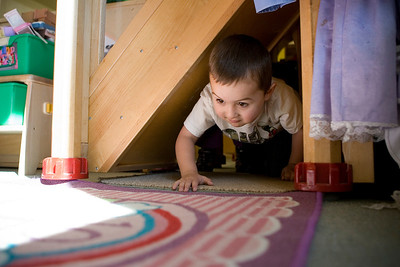 Mike Greene - mgreene@shawmedia.com George Jones, 4, crawls under stairs while playing a game at House of Children Tuesday, April 10, 2012 in Woodstock.