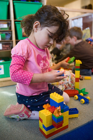 Mike Greene - mgreene@shawmedia.com Bella Schlopp (cq), 3, plays with building blocks Tuesday, April 10, 2012 at House of Children in Woodstock.