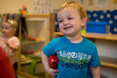 Mike Greene - mgreene@shawmedia.com Jonah Kelley, 1, smiles while playing with a phone Tuesday, April 10, 2012 at House of Children in Woodstock.
