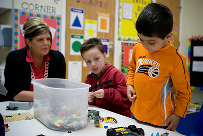 Mike Greene - mgreene@shawmedia.com Julian Segura (cq), 4, picks out Lego pieces to play with as Braden Clark, 5, and Shelly Rebman (cq) watch on Tuesday, April 10, 2012 at House of Children in Woodstock.