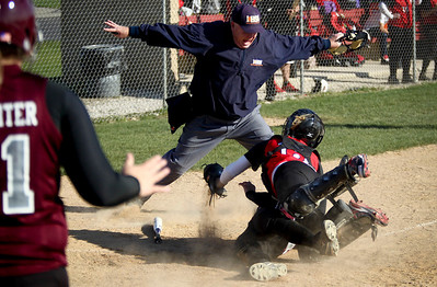 Jenny Kane - jkane@shawmedia.com Wed. April 11, 2012, Huntley's Katelyn Behrens tries to tag a Prairie Ridge player out during the second inning. Prairie Ridge defeated Huntley 14-1 during their FVC Valley Division matchup.
