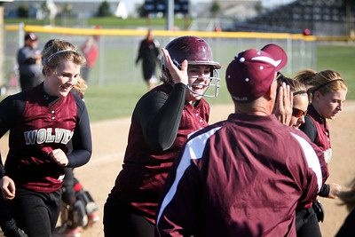 Jenny Kane - jkane@shawmedia.com Wed. April 11, 2012, Prairie Ridge's Marissa Richter, (center) high fives teammates and coaches after hitting a home run during their FVC Valley Division matchup against Huntley.