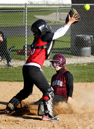Jenny Kane - jkane@shawmedia.com Wed. April 11, 2012, Huntley catcher Katelyn Behrens tries to tag Prairie Ridge's Sammy Hempen out at home. Hempen was safe. Prairie Ridge defeated Huntley 14-1 during their FVC Valley Division matchup.