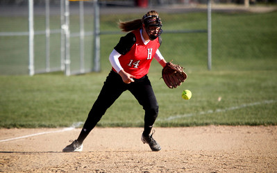 Jenny Kane - jkane@shawmedia.com Wed. April 11, 2012, Huntley's third baseman Tamara Funke grounds a ball during their FVC Valley Division matchup against Prairie Ridge.