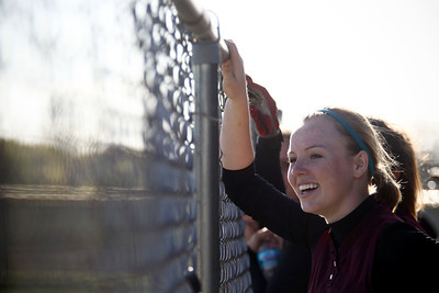 Jenny Kane - jkane@shawmedia.com Wed. April 11, 2012, Prairie Ridge's Claire Bowman cheers on her team while they are at bat during the second inning of their game against Huntley.