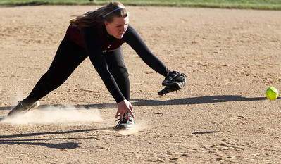 Jenny Kane - jkane@shawmedia.com Wed. April 11, 2012, Prairie Ridge's Grace Jamieson misses a grounder during their FVC Valley Division matchup against Huntley.