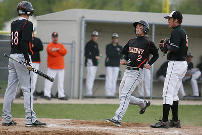 Mike Greene - mgreene@shawmedia.com McHenry's Kyle Clark (center) crosses home plate after a passed ball thrown by Crystal Lake Central's Stuart Streit (right) during a game Friday, April 13, 2012 in Crystal Lake. Clark started a four-run comeback in the seventh inning leading McHenry to a 5-3 victory.