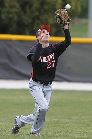 Mike Greene - mgreene@shawmedia.com McHenry's Alex Obenauf catches a fly ball in the outfield during a game against Crystal Lake Central Friday, April 13, 2012 in Crystal Lake. McHenry won the game 5-3.