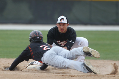Mike Greene - mgreene@shawmedia.com Crystal Lake Central's Connor Skrypek prepares to place a tag on McHenry's Kyle Clark during a game Friday, April 13, 2012 in Crystal Lake. Clark was thrown out on the play. McHenry defeated Crystal Lake Central 5-3.