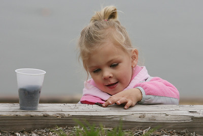 Mike Greene - mgreene@shawmedia.com Taylor Spencer, 3, plays with her bait while participate in the annual Veteran Acres Family Fishing Derby Saturday, April 14, 2012 in Crystal Lake. The event, which featured free fishing lessons and hands-on fishing demos, was put on by the Crystal Lake Park District and the Crystal Lake Anglers.