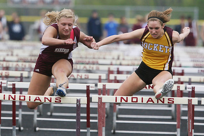 Mike Greene - mgreene@shawmedia.com Marengo's Allison Rogutich (left) and Richmond-Burton's Talia Sheedlo battle during the girls 100m hurdles at the Ed Reeves Invitational track meet Saturday, April 14, 2012 in Marengo.
