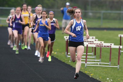 Mike Greene - mgreene@shawmedia.com Woodstock's Maura Beattie leads a pack of racers during the girls 3200m run at the Ed Reeves Invitational track meet Saturday, April 14, 2012 in Marengo. Beattie took first place in the event.