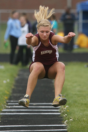 Mike Greene - mgreene@shawmedia.com Marengo's Allison Rogutich (cq) lauches through the air while competing in the girls triple jump at the Ed Reeves Invitational track meet Saturday, April 14, 2012 in Marengo. Rogutich took first place in both the triple jump and long jump competitions.