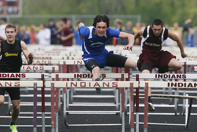 Mike Greene - mgreene@shawmedia.com Woodstock's Tyler Parsons jumps over a hurdle during the boys 110m hurdles at the Ed Reeves Invitational track meet Saturday, April 14, 2012 in Marengo. Parsons took first place in the event and helped Woodstock win the overall points competition for the meet.