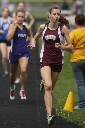 Mike Greene - mgreene@shawmedia.com Marengo's Allie Sprague races ahead of Hampshire's Cassie Kruse during the 800m race at the Ed Reeves Invitational track meet Saturday, April 14, 2012 in Marengo. Sprauge won the race with Kruse taking second place.