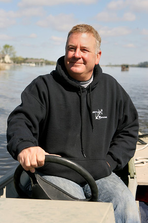 Mike Greene - mgreene@shawmedia.com Chain O' Lakes Marina manager Steve Moulis pilots through a channel on Fox Lake Tuesday, April 17, 2012 in Fox Lake. Moulis, whose family has operated on the lake since 1952, says more people are using pontoon boats on the lake as a response to increased gas prices.