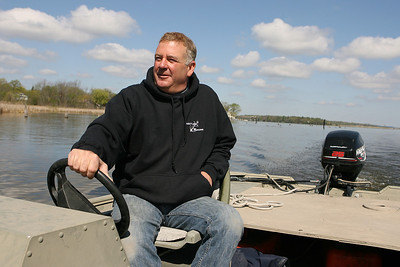 Mike Greene - mgreene@shawmedia.com Chain O' Lakes Marina manager Steve Moulis pilots through a channel on Fox Lake Tuesday, April 17, 2012 in Fox Lake. Moulis, whose grandfather started Chain O' Lakes Marina in 1952, says more people are using pontoon boats on the lake as a response to increased gas prices.